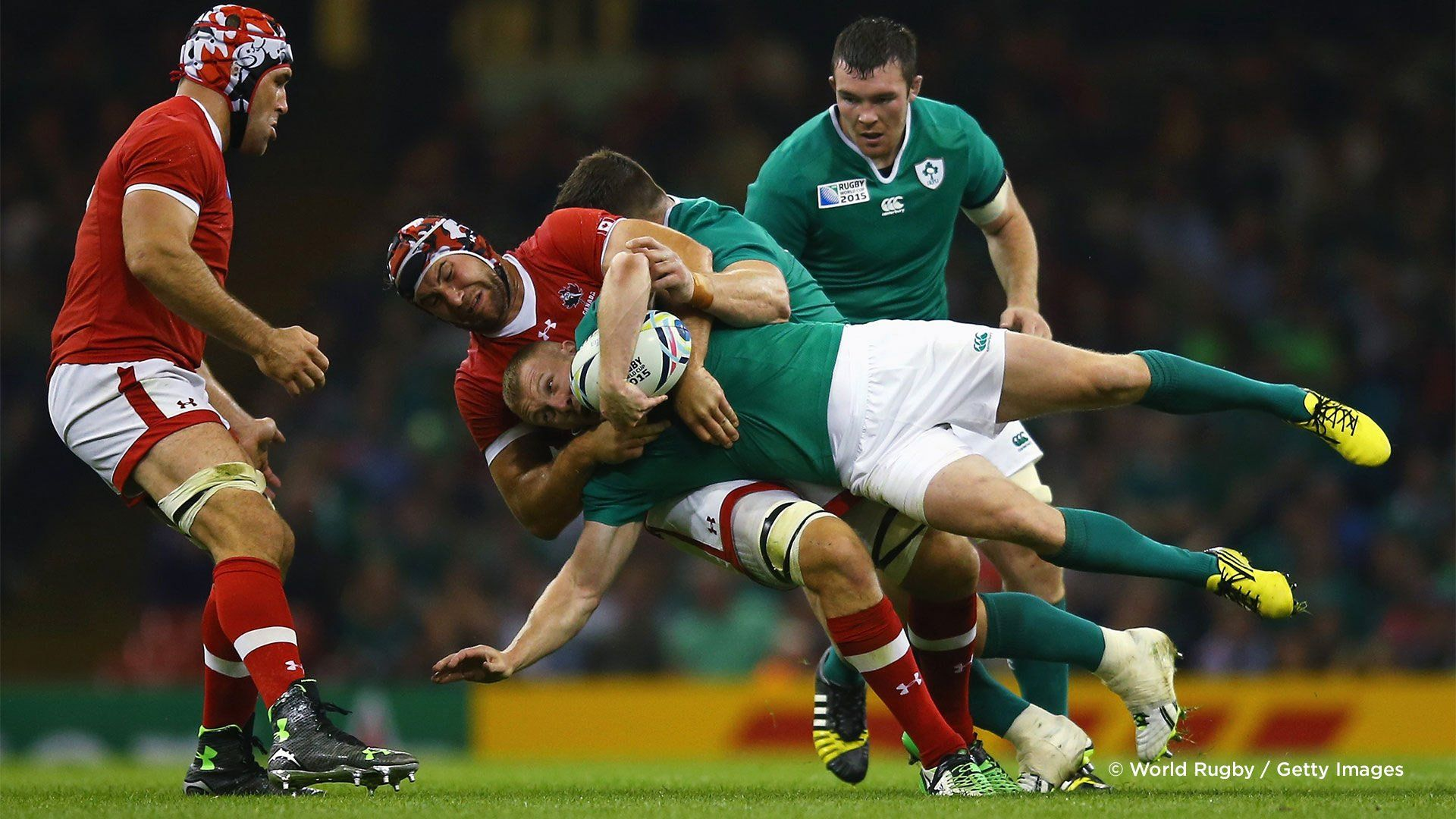 A Canadian player tackles an Irish player in a 2015 Rugby World Cup match. Photo by Richard Heathcote.